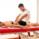 Osteopath doing lumbar myofascial treatment - PhotoDune Item for Sale