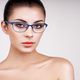 Woman with long eyelashes in eyeglasses - PhotoDune Item for Sale