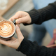 Coffee latte heart texture in hand of tourists. - PhotoDune Item for Sale