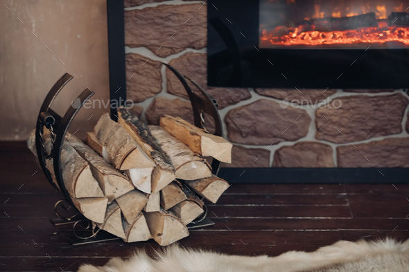 Pile of logs next to the fireplace - Stock Photo - Images