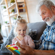 Grandparents playing and having fun with their granddaughter - PhotoDune Item for Sale