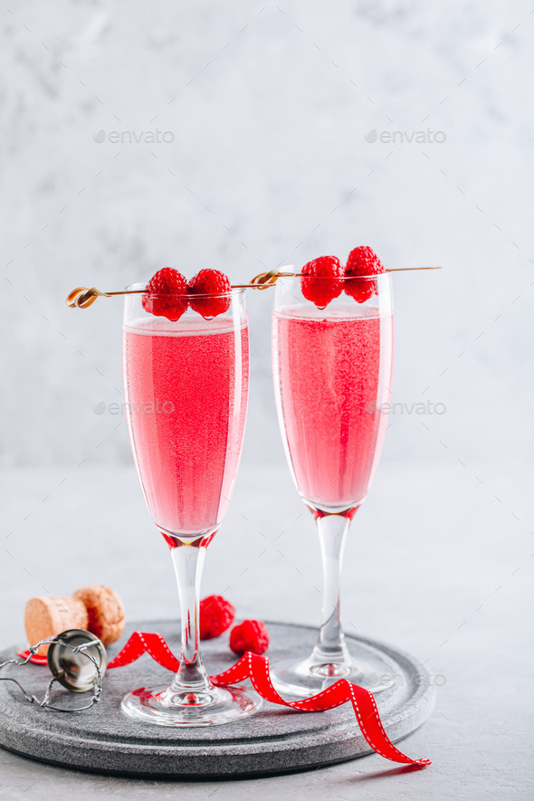 Pink cocktail with champagne or prosecco and fresh raspberries for  Valentine's day. - Stock Photo - Images
