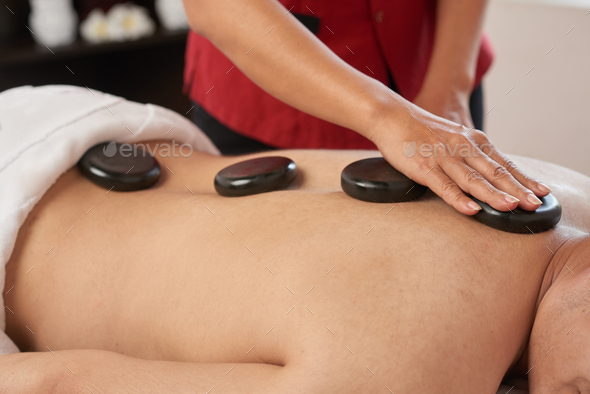 Receiving Massage with Hot Stones - Stock Photo - Images
