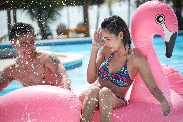 Spending Hot Day in Swimming Pool - Stock Photo - Images