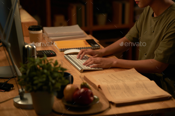 Student typing on computer - Stock Photo - Images