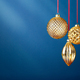 Three Golden Christmas Baubles on Blue. - PhotoDune Item for Sale