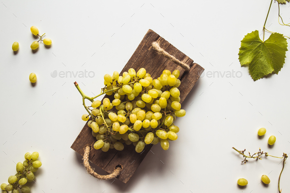 fresh grape on cutting board - Stock Photo - Images