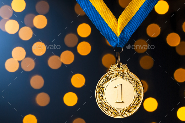 Gold champion or winners medallion on a ribbon - Stock Photo - Images