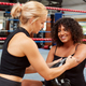 Personal Trainer Helping Female Boxer In Gym To Put On Boxing Gloves In Gym - PhotoDune Item for Sale