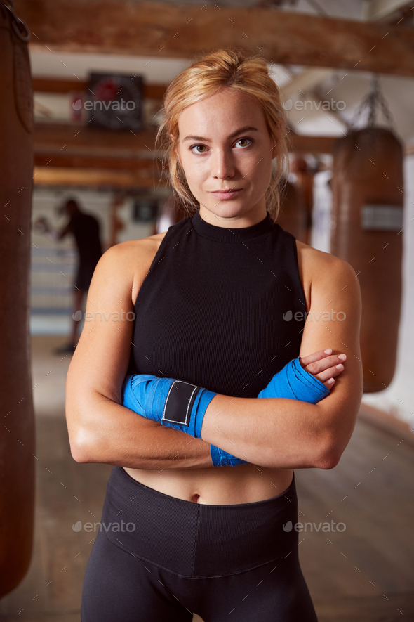Portrait Of Female Boxer With Protective Wraps On Hands Training In Gym - Stock Photo - Images