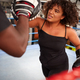 Male Personal Trainer Sparring With Female Boxer In Gym Using Training Gloves - PhotoDune Item for Sale