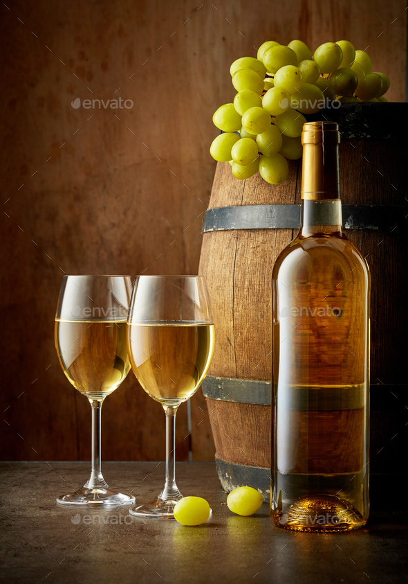 bottle and two glasses of white wine - Stock Photo - Images