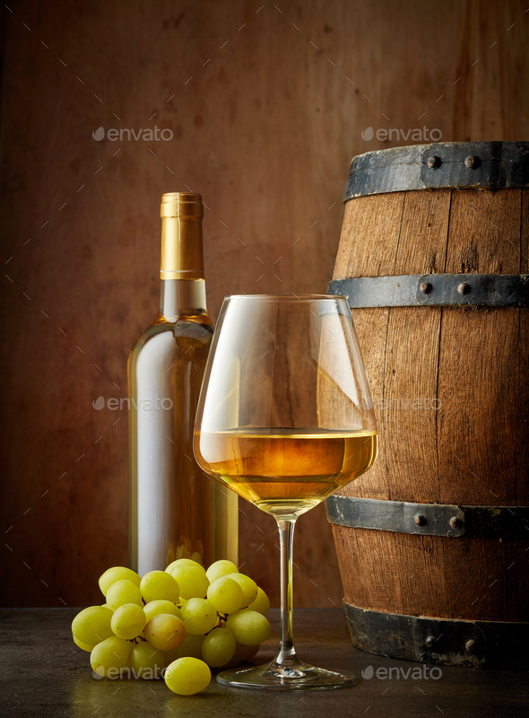 glass and bottle of white wine - Stock Photo - Images
