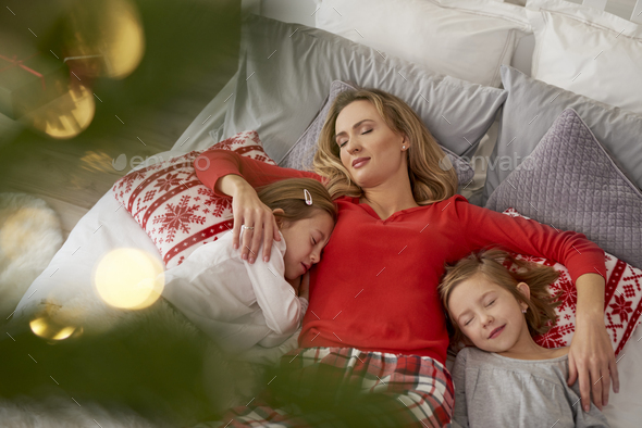 Sleeping family in Christmas morning - Stock Photo - Images