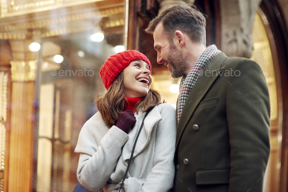 Romantic moment during big Christmas shopping - Stock Photo - Images