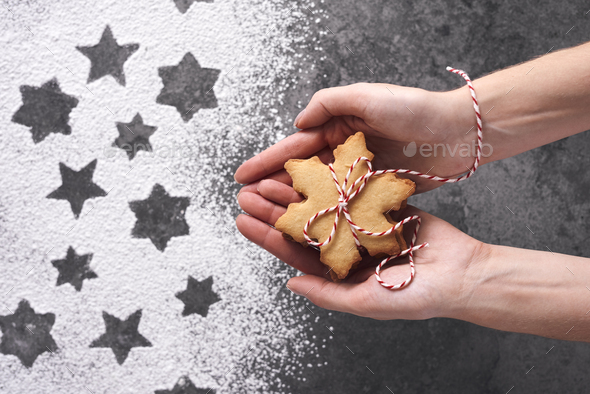 Close up of woman's hands holding gingerbread cookies - Stock Photo - Images