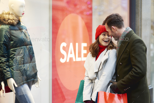 Happy couple during the window shopping in wintertime - Stock Photo - Images