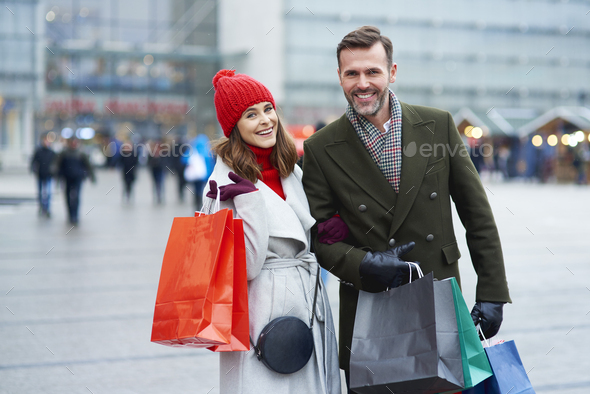 Couple with shopping bags in the city - Stock Photo - Images