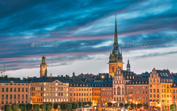 Stockholm, Sweden. Scenic View Of Skyline At Evening Night. Tower Of Storkyrkan - The Great Church - Stock Photo - Images