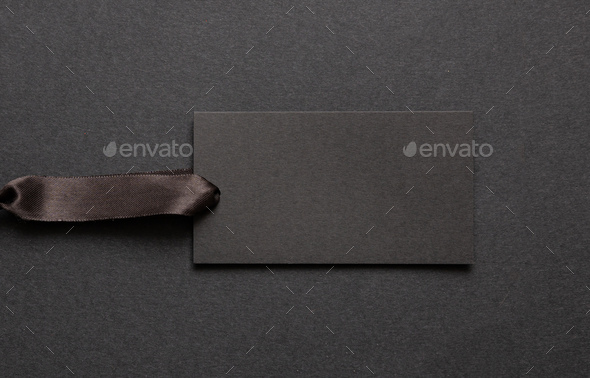 Black recycled price card against black background - Stock Photo - Images