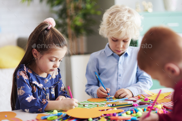 Group of focused children during art class - Stock Photo - Images