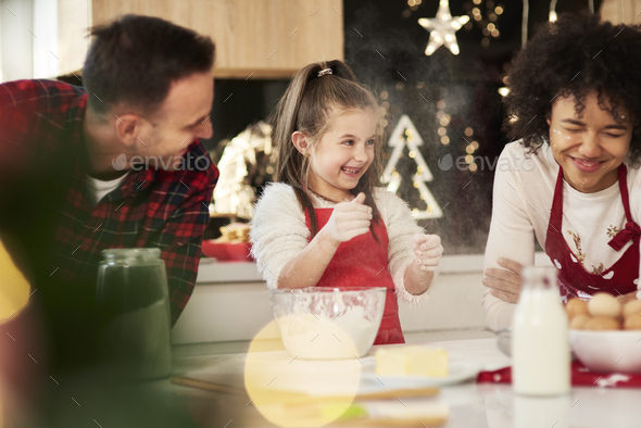 Family enjoying in the kitchen at Christmas - Stock Photo - Images