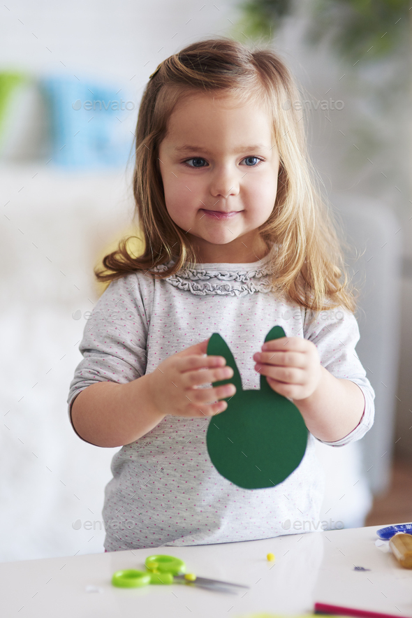 Cute girl holding handmade easter decorations - Stock Photo - Images