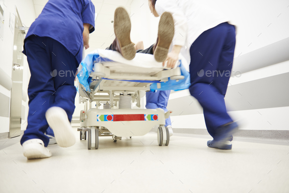 Doctors running for the surgery - Stock Photo - Images