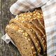 Sliced whole grain bread with oat flakes. Wholemeal bread. - PhotoDune Item for Sale