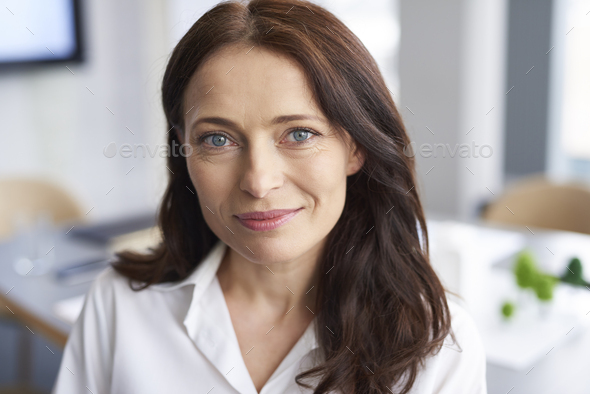 Portrait of smiling businesswoman in the office - Stock Photo - Images