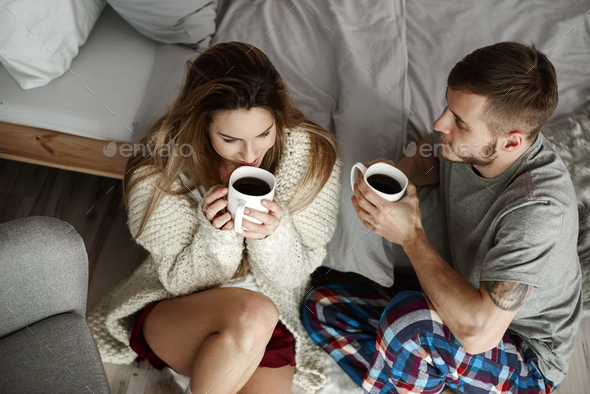 Happy couple talking and drinking coffee - Stock Photo - Images