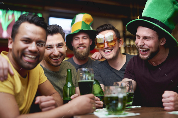 Time for beer with friends in the pub - Stock Photo - Images
