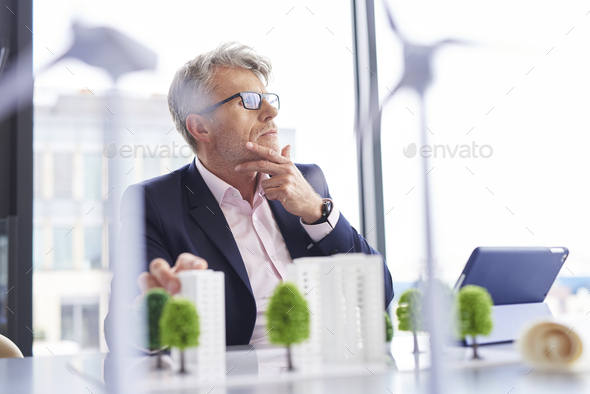 Busy businessman thinking about new solutions - Stock Photo - Images