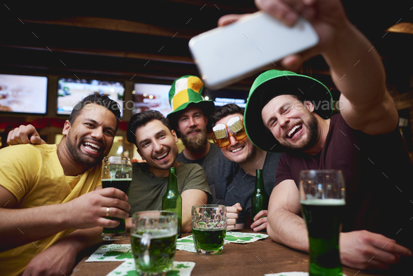 Great selfie of group of friends in the pub - Stock Photo - Images