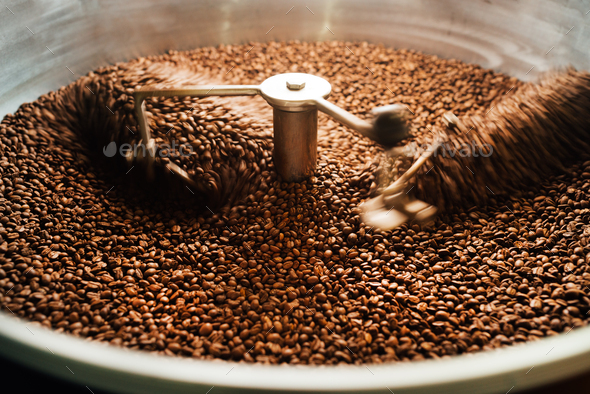 beans in a moving coffee cooling mixer - Stock Photo - Images