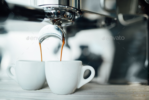 extraction of espresso from double open-end portafilter holder - Stock Photo - Images
