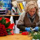 Florist with professional clothing in a nursery. - PhotoDune Item for Sale