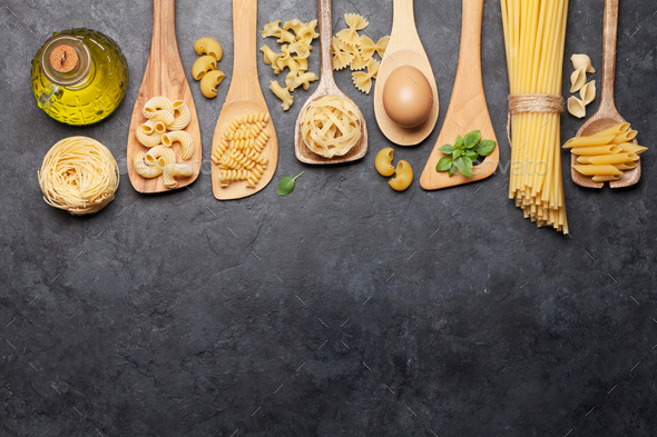 Various pasta in spoons - Stock Photo - Images