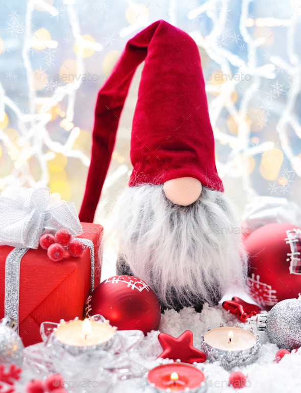 Christmas composition with the gnome, candles, gifts and festive decorations - Stock Photo - Images