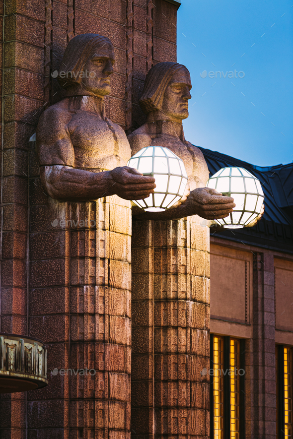 Helsinki, Finland. Night View Of Two Pairs Of Statues Holding The Spherical Lamps On Entrance To - Stock Photo - Images