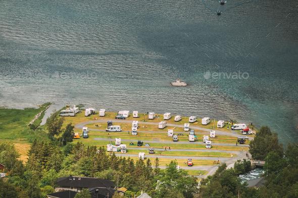 Geirangerfjord, Norway. Caravan Motorhome Cars Parking Near Harbor. Aerial View In Summer Day - Stock Photo - Images