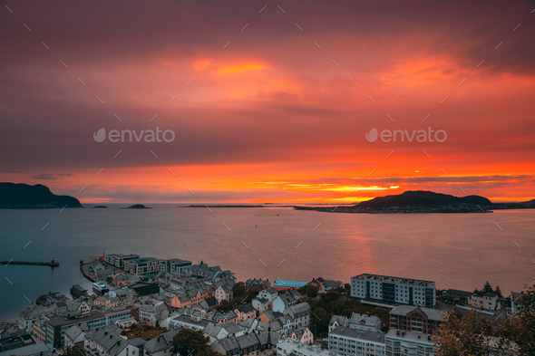 Alesund, Norway. Amazing Natural Bright Dramatic Sky In Warm Colours Above Alesund Valderoya And - Stock Photo - Images