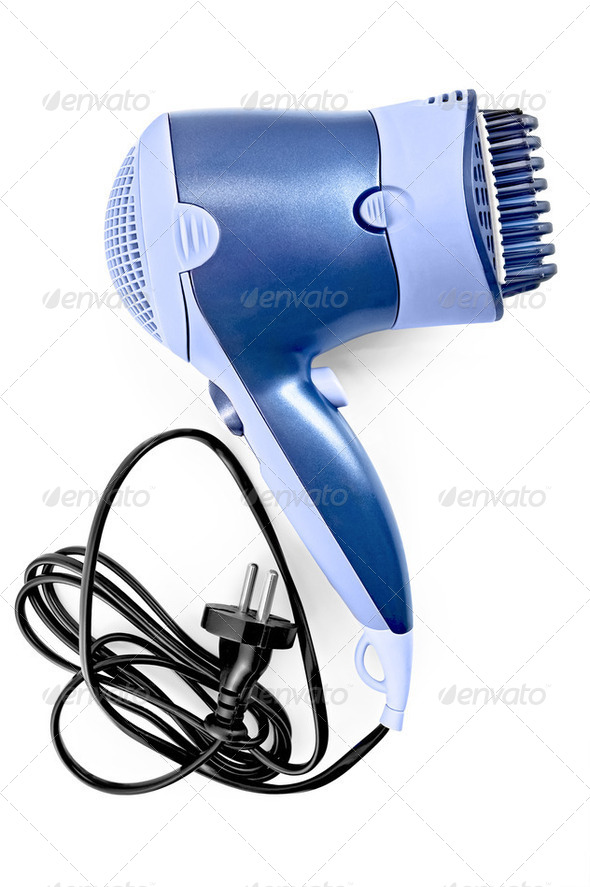 Hair dryer with comb attachment - Stock Photo - Images