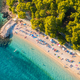 Aerial view of sandy beach with colorful umbrellas, blue sea sea - PhotoDune Item for Sale