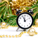 Black Alarm clock and fir tree branch, gold christmas decorations - PhotoDune Item for Sale