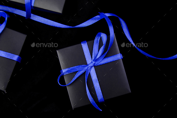 Luxury black gift boxes with blue ribbon - Stock Photo - Images