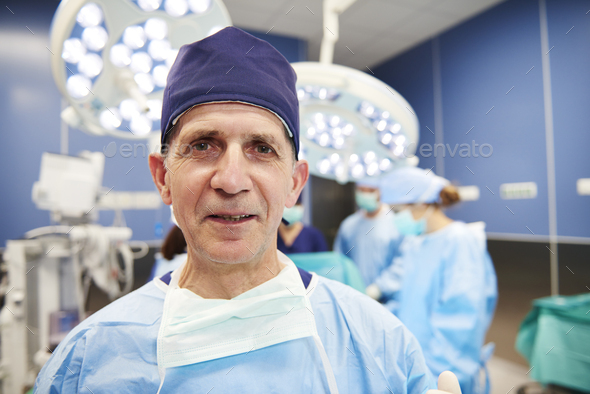 Portrait of smiling surgeon in the operating room - Stock Photo - Images