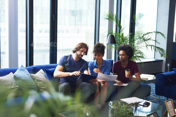 Young coworkers working on tablet - Stock Photo - Images
