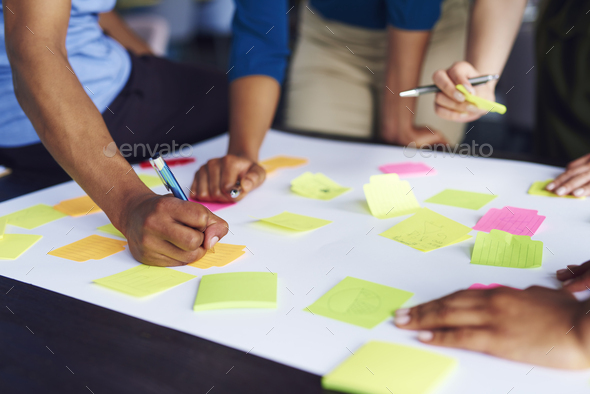 Brainstorming of young business coworkers - Stock Photo - Images
