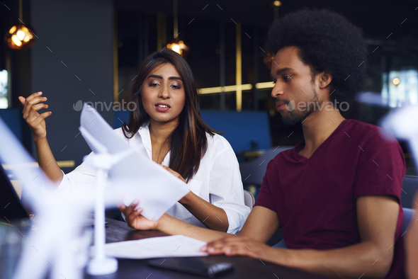Business couple analyzing the documents at work - Stock Photo - Images
